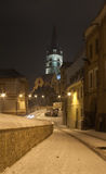 Cathedral church Sibiu Transylvania by night snow. Cathedral church of Sibiu Transylvania by night with snow and street light Royalty Free Stock Photos