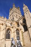 Gloucester Cathedral. Cathedral church of St Peter and the Holy and Indivisible Trinity with metal nun statues in the foreground, Gloucester, Gloucestershire Royalty Free Stock Photography