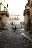 Lecce, the amazing baroque Cathedral in Piazza Duomo at twilight time with a bike, Italy. Stock Photography