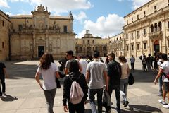 Cathedral of the city of Lecce in Apulia, Italy. Cathedral of the city of Lecce  with kids and students in Apulia, Italy, dedicated to the Assumption of the Royalty Free Stock Photos