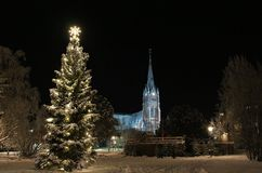 Cathedral and city park in Lulea in the frosty winter coats Royalty Free Stock Images