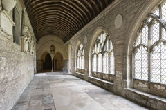 Cathedral cloister arcade, Chichester. Inner view of arcade in cloister of  famous medieval church in historic town, Chichester, West Sussex Stock Images
