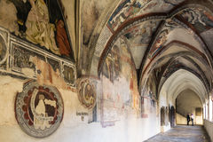 Cathedral cloister with the frescoed wall. Stock Images