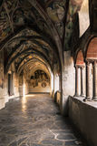 Cathedral cloister with the frescoed wall. Royalty Free Stock Images