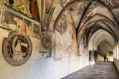 Cathedral cloister with the frescoed wall. Royalty Free Stock Photography