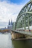 Cathedral of Cologne with iron arcs of Hohenzollern bridge, Colo Royalty Free Stock Image