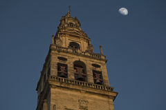 Cathedral of Cordoba Bell tower 3. Cathedral of Cordoba Bell tower from outside the street with moon Stock Images