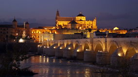 Cathedral of Cordoba and Roman bridge in evening stock video footage