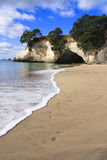 Cathedral Cove Coromandel Arch. Footprints on beach in New Zealand Royalty Free Stock Images
