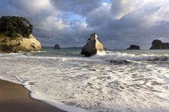 Cathedral Cove in New Zealand in the morning. Sunrise at Cathedral Cove in New Zealand stock photography