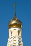 Cathedral dome. The gilt dome of a cathedral against the blue sky Royalty Free Stock Photography