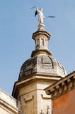 Cathedral Dome. Angel on top of Church against blue ski stock photo