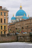 Cathedral dome behind apartment building near the river. St. Petersburg, Russia - February 14, 2016: Dome of the Trinity Cathedral behind the apartment building Royalty Free Stock Photo