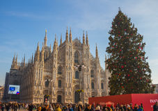 Cathedral of Duomo during Christmas holidays, Milano, Italy. MILAN, ITALY - DECEMBER 09, 2016: Duomo di Milano on a sunny day full of people walking Stock Images