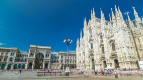 Cathedral Duomo di Milano and Vittorio Emanuele gallery timelapse hyperlapse in Square Piazza Duomo at sunny summer day. Milan, Italy. People walking on the stock footage