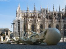 Cathedral Duomo  in Milan. Cathedral Duomo  in Milan  at   left wing of Cathedral.  In front view a skeleton. Italy stock images
