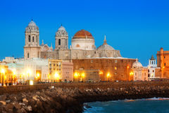 Cathedral and  embankment in evening time. Cadiz Stock Images