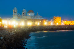 Cathedral and  embankment in night. Cadiz Stock Photography