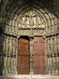 Cathedral entrance. Chartres cathedral (France) entrance with ancient wooden door and beautiful sculpture stock photo