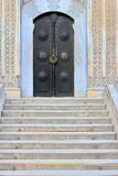 Cathedral Entrance. Metallic decorated medieval black door above stairway Royalty Free Stock Photography