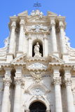 Cathedral façade of syracuse, italy. Baroque façade of the cathedral of syracuse in italy under a blue summer sky stock photography