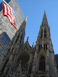 Cathedral and Flag. This is a wide angle view of St. Patrick's Cathedral royalty free stock images