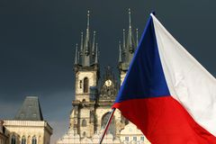 Cathedral with flag in Prague. Cathedral in Prague with flag of the Czech Republic Stock Images