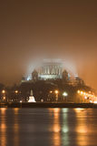 Cathedral in the fog. St Isaac's Cathedral in the fog on the other side of frozen river in St Petersburg Stock Photography