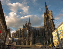 Cathedral on the forecourt Cologne. At the station, always turbulent life of people, and the eternity beyond time and space. With every look, a new insight Royalty Free Stock Photography