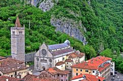 The cathedral of Gemona del Friuli. A view of the cathedral of Gemona del Friuli surrounded by the mountains in northern Italy Stock Image