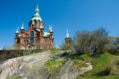 Cathedral in Helsinki. Uspenski Cathedral in Helsinki (Finland). Viewed from below over the rocks during nice summer day stock images