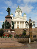 Cathedral in Helsinki. Main cathedral of Helsinki, Finland. On the left statue of Russian czar Alexander II royalty free stock image