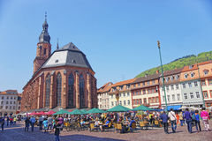 Cathedral of Holy Spirit and people on square in Heidelberg Royalty Free Stock Photos