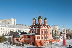 Cathedral of the icon of the Mother of God `the Sign` and the Church of St. George the victorious on Pskov hill with a bell tower. Street Varvarka. Moscow Royalty Free Stock Image