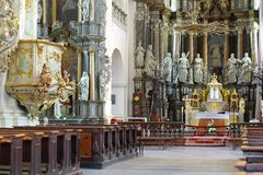 Cathedral interior. With altar and seats Stock Photo