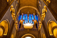 Cathedral interior and pipe organ. Royalty Free Stock Image
