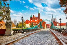 Cathedral Island in Wroclaw Poland green bridge. With view on of St John the Baptist picturesque panorama medieval town blue sky and white cloud Royalty Free Stock Photo