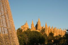 Cathedral La Seu detail and Christmas light. Decorations at sunset on December 5, 2017 in Palma de Mallorca, Balearic islands, Spain royalty free stock photo