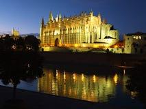 Cathedral of la Seu Mallorca. At Palma de Mallorca, Balearic islands in Spain. Night scene with reflection over fountain stock photography