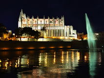 Cathedral of la Seu Mallorca. At Palma de Mallorca, Balearic islands in Spain. Night scene with reflection over fountain Royalty Free Stock Image