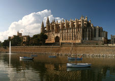 Cathedral La Seu in Palma de Mallorca, Spain. This church is one of the famous landmarks of Mallorca (Majorca). In the foreground Park del Mar with the salt royalty free stock image