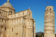 The Cathedral and the leaning tower in Pisa. Piazza dei Miracoli in Pisa, Italy. The Cathedral near the leaning belltower Stock Images
