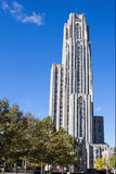 Cathedral of Learning Right. Cathedral of Learning Towers Over Green and Yellow Trees Against a Deep Blue Sky In Oakland a sub-city of Pittsburgh Pennsylvania stock photography