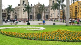 Cathedral Of Lima. Lima, Peru - March 17, 2016 : Tourists and peruvian  walking in the Plaza de Armas in front of the Cathedral of Lima, Lima, Peru stock video footage
