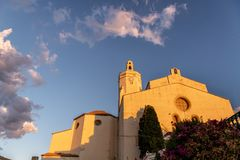 Cathedral lit by morning sun in Cadaques, Spain royalty free stock photos