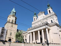 Cathedral, Lublin, Poland. The Cathedral of Saint John The Baptist and The Evangelist, also known as the sanctuary of the weeping Madonna (on the left) and the Royalty Free Stock Photo