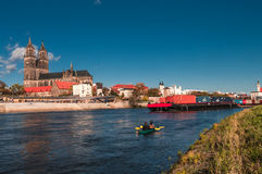 Cathedral of Magdeburg at river Elbe, barge and canoeing Stock Photos
