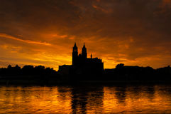 Cathedral of Magdeburg and the river Elbe at sundown Royalty Free Stock Photos
