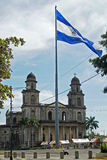 Cathedral, Managua, Nicaragua. MANAGUA, NICARAGUA - NOVEMBER 10, 2007: Flagpole with Nicaraguan national flag and ruin of the cathedral in the background on stock photography