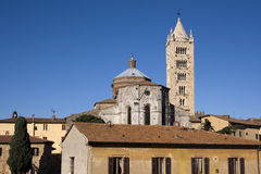 Cathedral of Massa Marittima - Tuscany. Back side view of the apse, romanesque bell tower - Italy Royalty Free Stock Photography
